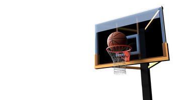 baloncesto entrando en el aro sobre fondo blanco aislado foto