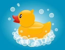 Yellow rubber duck in soap foam. Baby bathing toy. vector