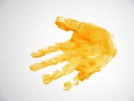 impresión de la mano del niño en el fondo de papel blanco foto
