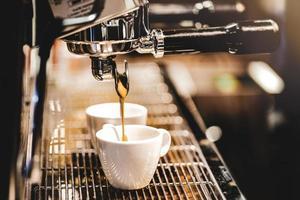 Espresso machine brewing a coffee photo
