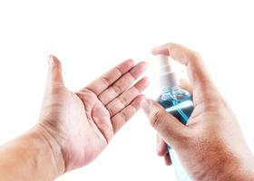 Hands using wash hand sanitizer gel photo