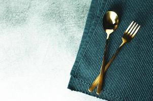 Fork and spoon on table background with space photo