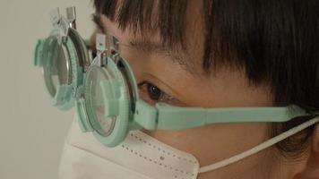 Eye testing and eyeglass assembly by experts optician. video