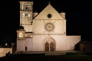 Assisi Basilica by night,  Umbria region, Italy. photo