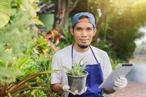 Asian man owner shop small business sale gardening online photo