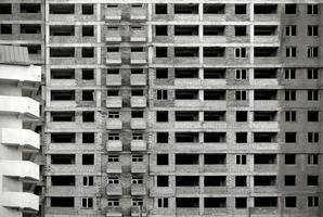 Unfinished building in black and white photo