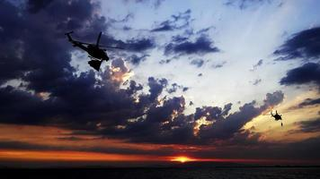 Helicopter is Passing in Cloudy Sunset Sky video