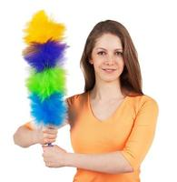 Woman with a brush to clean the dust photo