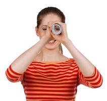 Girl looks in a folded magazine - spyglass photo