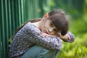 Sad little girl photo