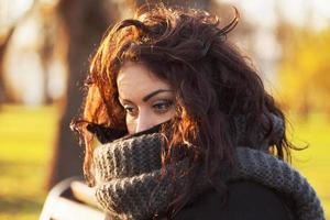 Sad, dark-haired woman photo