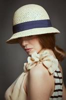 Stylish woman in retro wicker hat photo