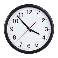 Office clock shows five minutes to four photo