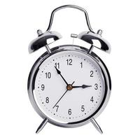 cinco minutos para las tres en un reloj despertador foto