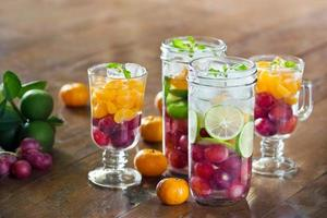Glass refreshing detox diet drinks of mix fruits photo
