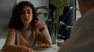 Woman talks to man at breakfast table photo