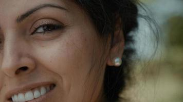 Right half of womens face smiling into camera lens photo