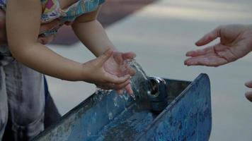 Slow motion of girl touching water in fountain photo
