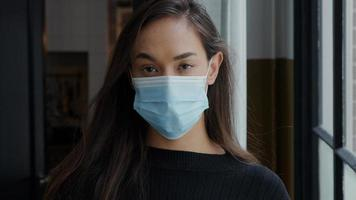 Head shot of young mixed race woman in face mask photo