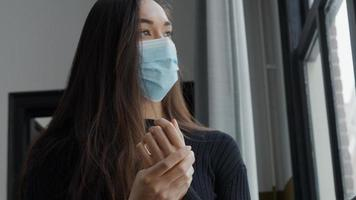 Hands of young mixed race woman with face mask photo