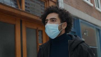 Young Middle Eastern man with face mask on photo