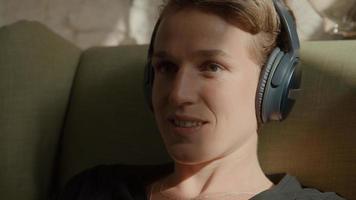 Woman putting headphone on ears photo