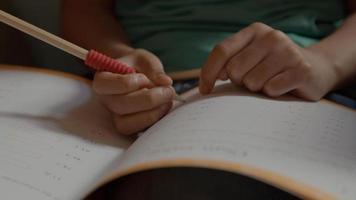 Boy doing maths in armchair photo