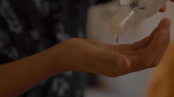 Boy putting hand gel in palm photo