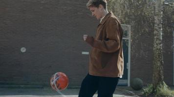 Woman doing football trick photo