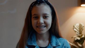 Girl smiling into camera lens photo