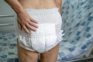 Asian senior woman patient wearing incontinence diaper photo