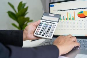 Asian accountant working financial reports accounting with graph photo