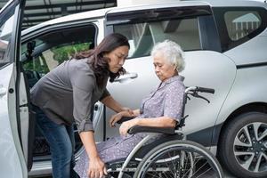Help and support asian senior patient prepare get to her car photo