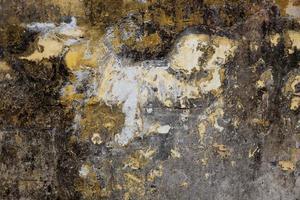 Vieja superficie enlucida de amarillo y gris. foto