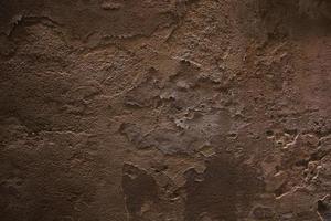 antiguo muro de piedra enlucida foto