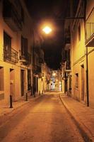 Deserted streets of old town lit a lantern photo
