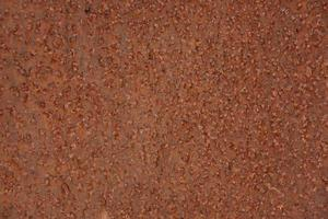 Metal surface is pitted with rust photo