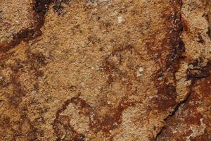 Brown stone with streaks of rust photo