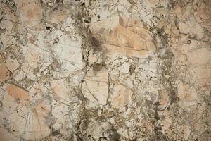 superficie de piedra con muchas pequeñas grietas foto