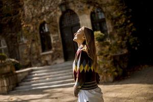 Pretty young woman walking in the autumn park photo