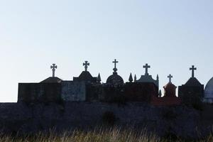 Silhouettes of crosses in a cemetery in Galicia, Spain. photo