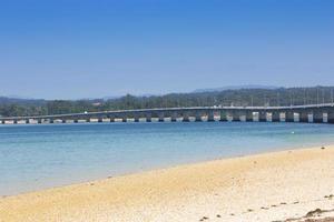 Long bridge linking an island to the mainland photo