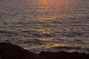 Blue sea at sunset photo