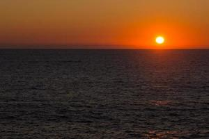 Sunset on the sea, on the Atlantic Ocean photo