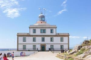 Lighthouse in Finisterre, end of the world at the Atlantic Ocean in Galicia, Spain photo