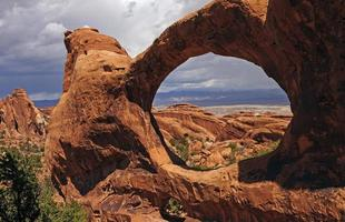 Dramatic Arch on Spring Day in the Desert photo