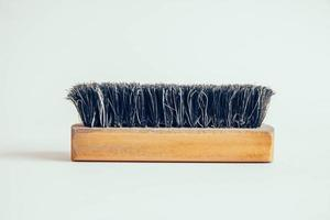 Wooden brush for clothes on a white background photo