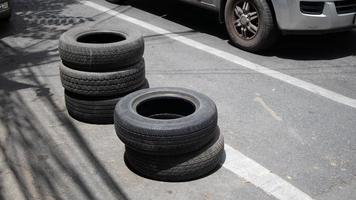 Bucket of vehicle tyre on the road photo