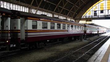 Locomotive train business in the train station,Cheap passenger. photo