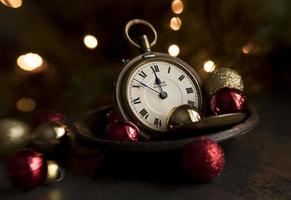 Clock in a cup with beautiful bokeh lights on a festive day. photo